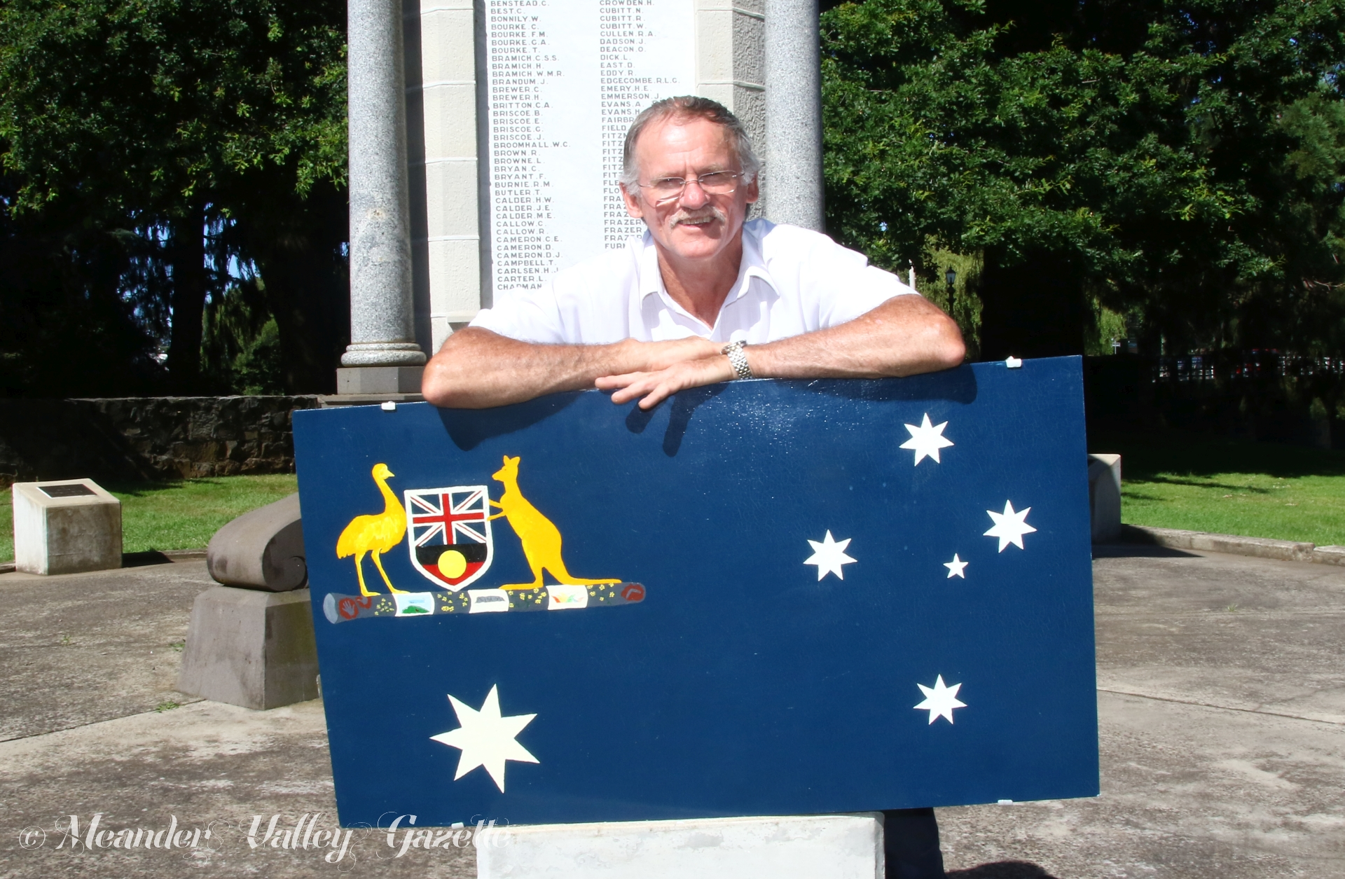 Peter Jago pictured with his design for the Australian flag