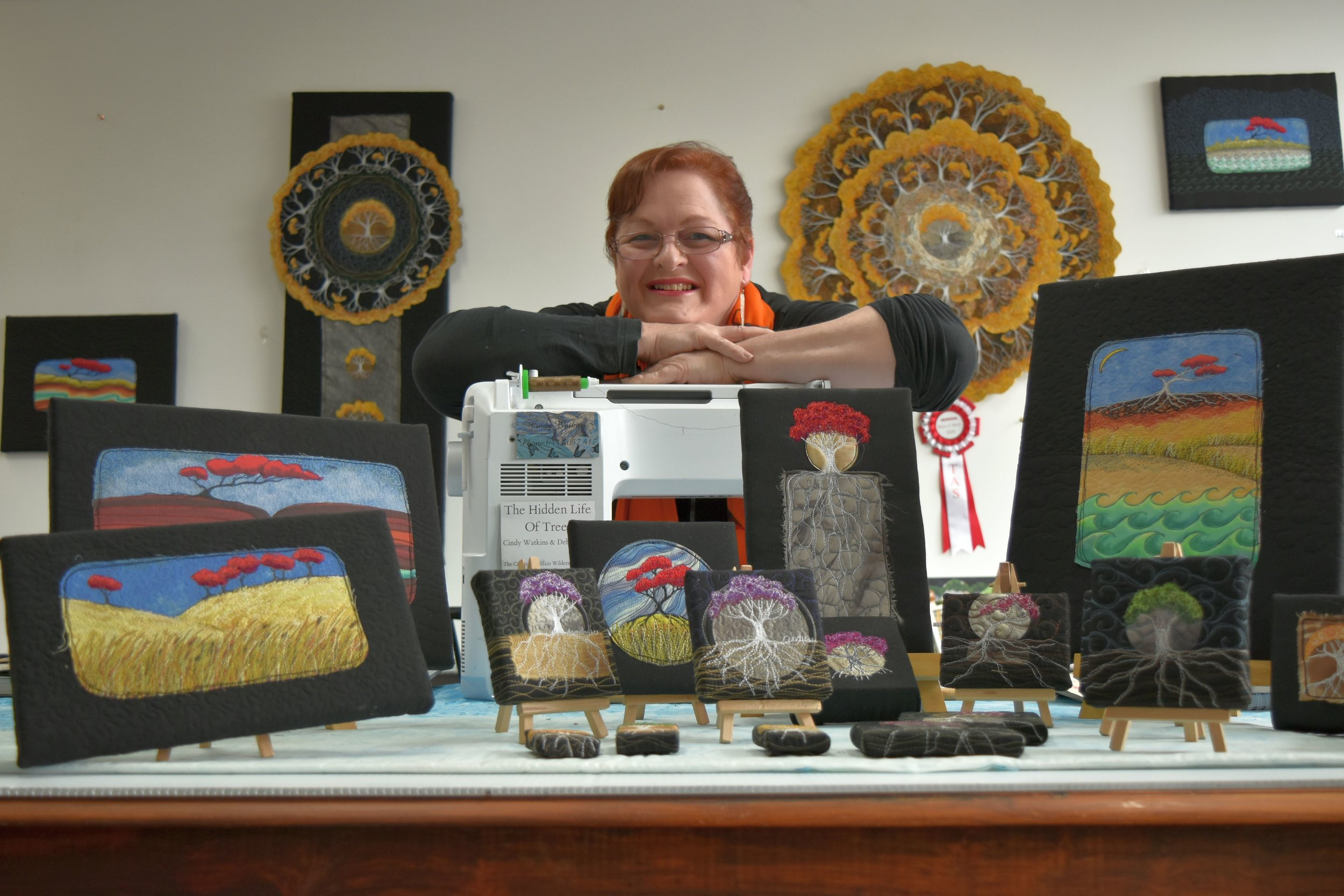 Golden Valley textile artist Cindy Watkins pictured with some of the works that make up her '5000 trees project'. Cindy will donate $2 from each tree sold.