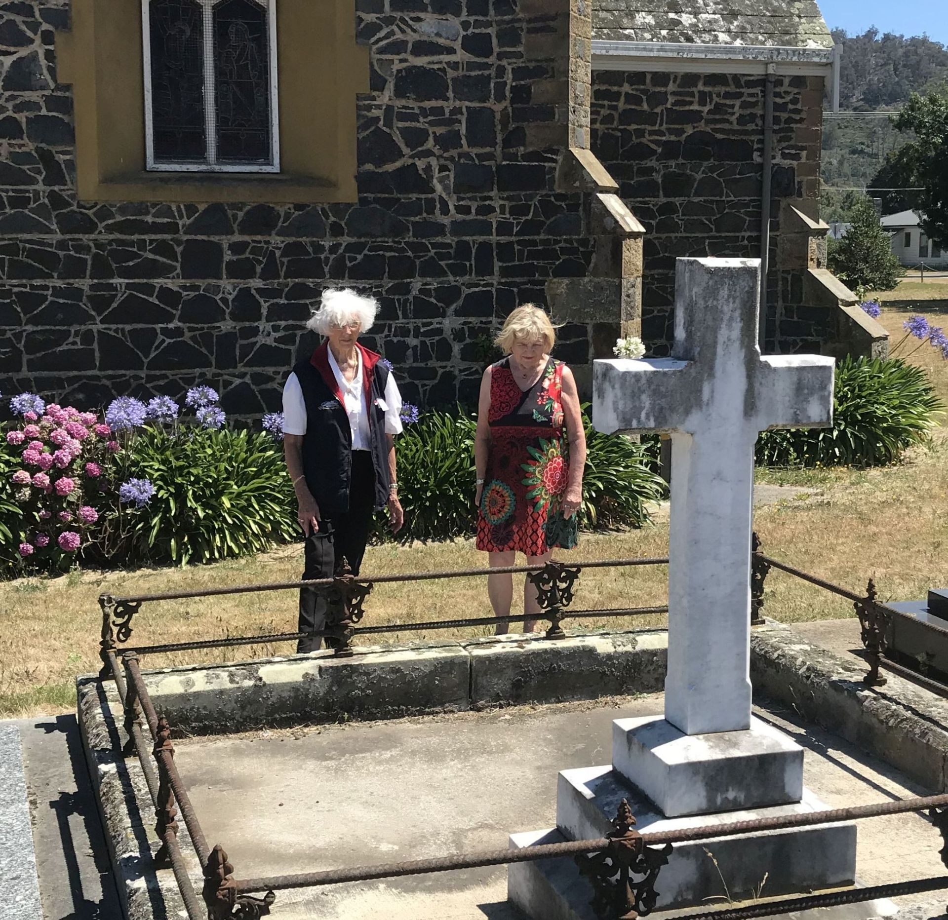 Thelma Wood (L) and Lorraine Carroll visit the gravesite of Thomas Reibey.   Photo | David Claridge