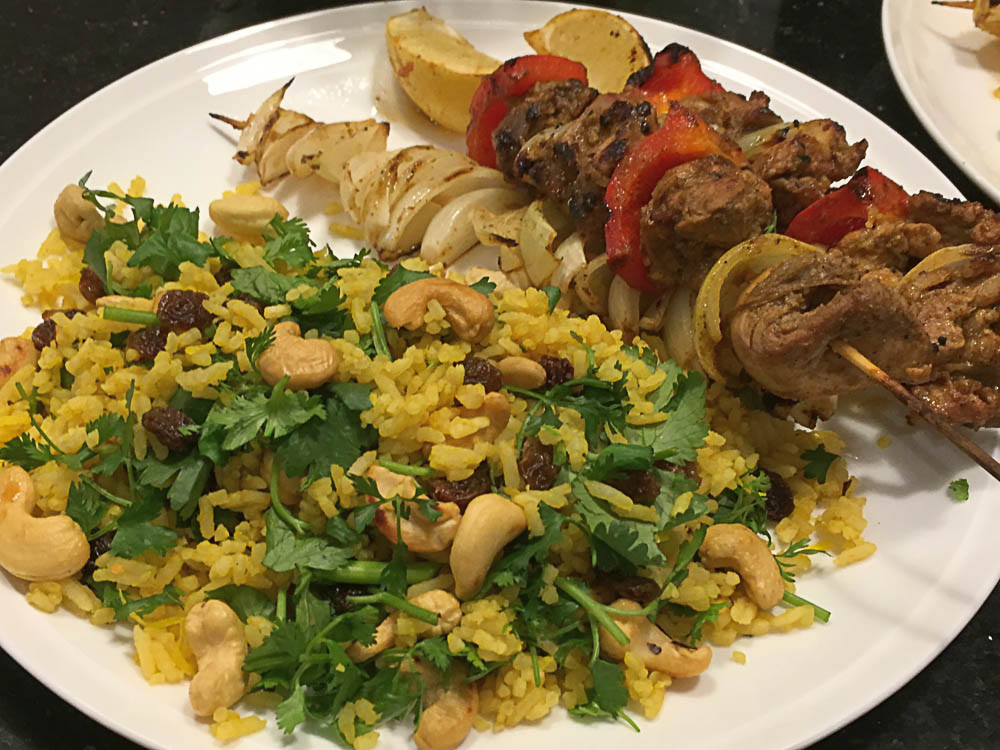 The bright colours of this indian style rice salad work well with the skewers of charry spiced chicken.   Photo   Mike Moores