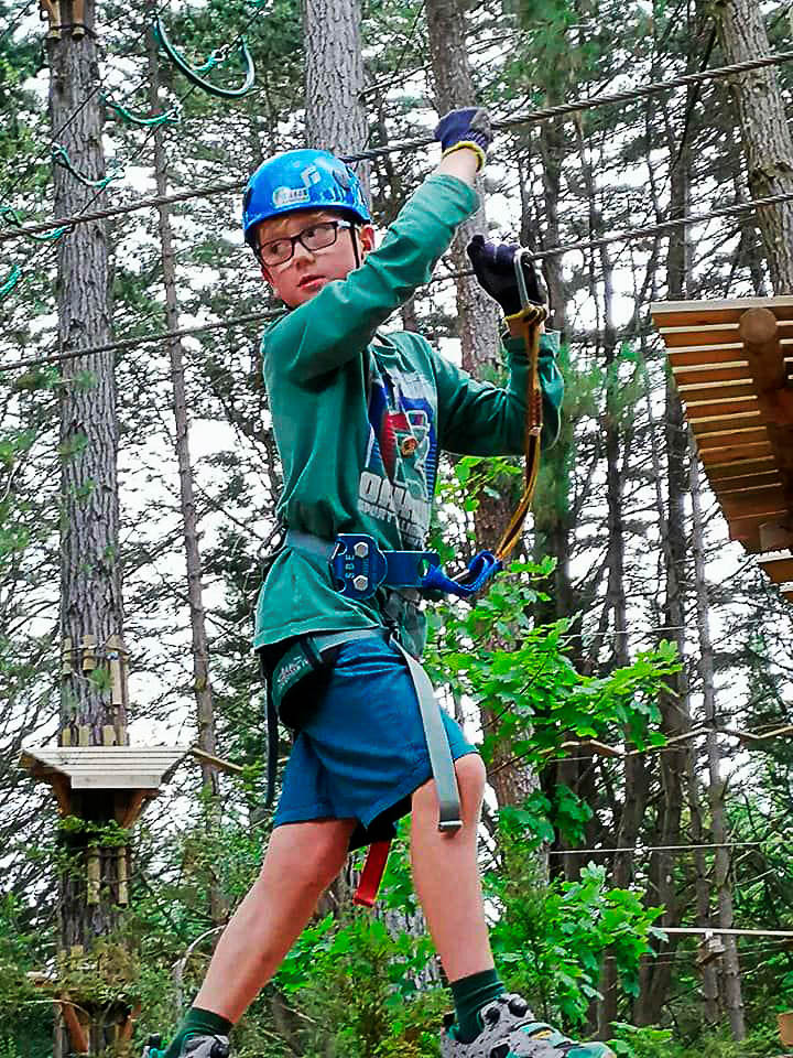 9-year-old Jez enjoys exploring the treetops at Hollybank during a retreat at Wonderland.   Photo | supplied