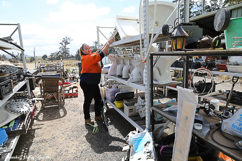 Tip shop assistant Jess Wall of Deloraine with a selection of toilet suites and hand basins starting at $10.00.   Photo | Mike Moores