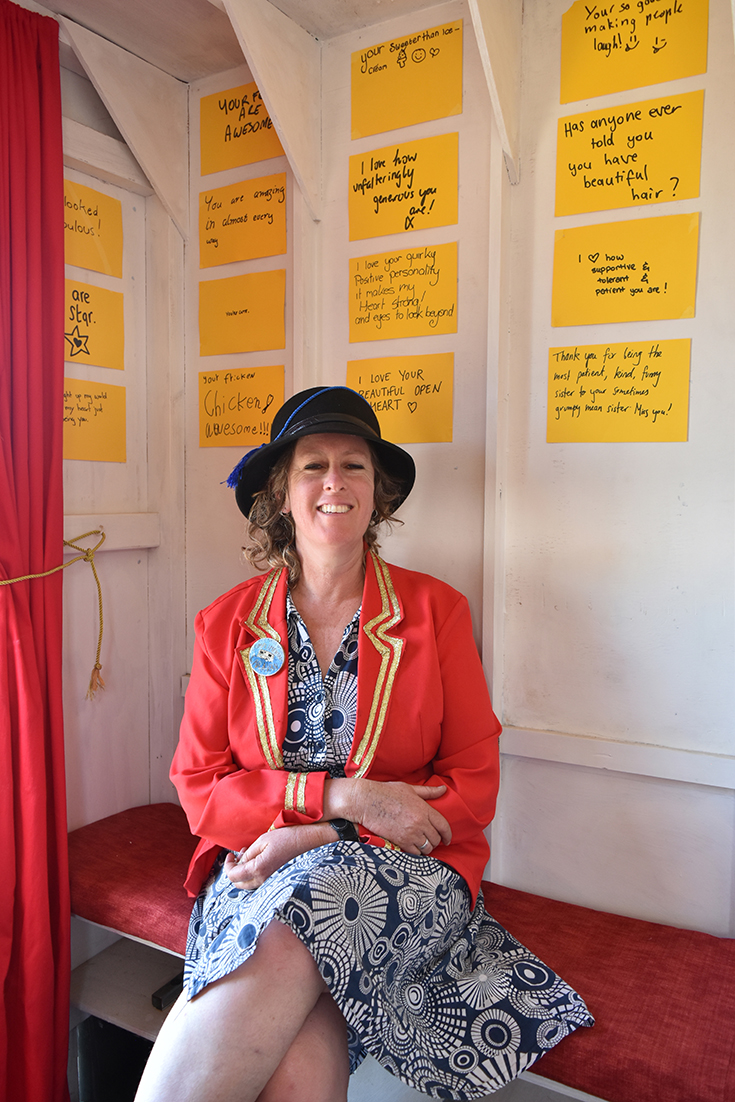 Rose Turtle Ertler in the doorway of The Complimentary Caravan   Photo | Emma Hodgkinson