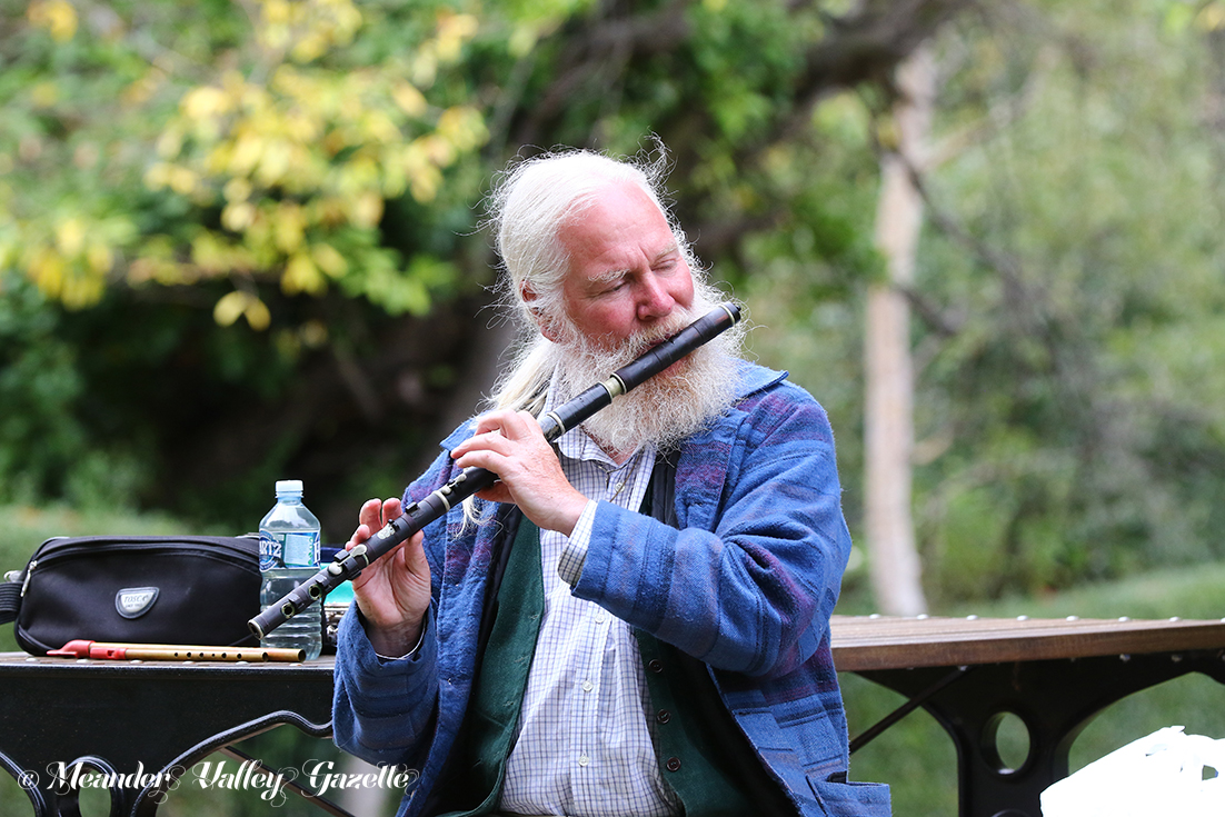 Brian Owens of Ouse, flute and tin whistle player, playing his Indian rosewood flute on the Westbury Village Green. Just one of Brian's collection of wind instruments, the flute was made in 1837 by an instrument maker called Joseph Wallis, in the Euston Road, London.   Photo | Mike Moores
