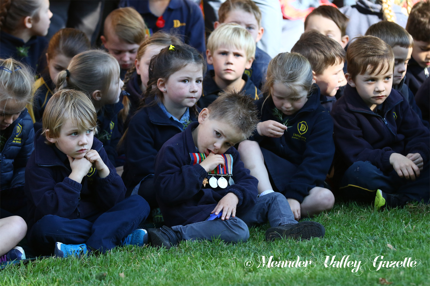 Four-year-old Malacai Chambers-White (centre front) and Deloraine Primary School classmates at the 11.00am Deloraine Anzac Day ceremony.  Photo by Mike Moores