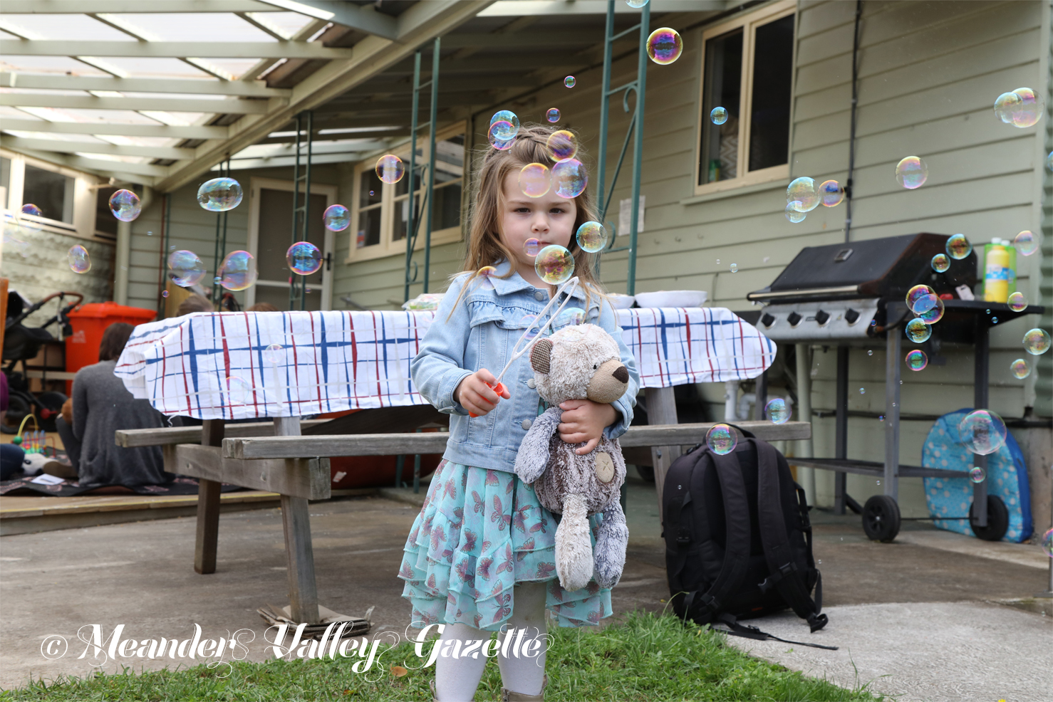 Three-year-old Lylah Ulbrich and her friend Ted, both from Biralee, are concentrating on getting that perfect bubble, at the Deloraine House Teddy Bears' Picnic.  Photo by Mike Moores