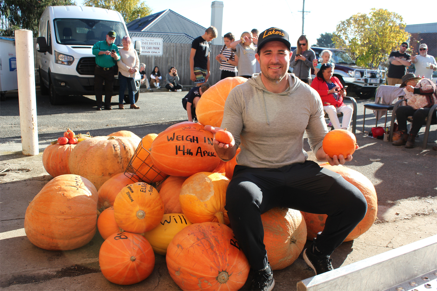 Winning pumpkin grower Andrew Gleeson enthroned on a heap of giant pumpkins.  Photo by Hayley Manning