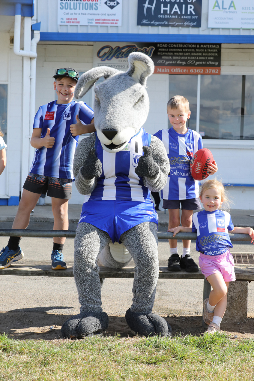 Deloraine Football Club's new mascot Kanga gets to know some of the club's rusted-on supporters. From left, Cooper Field, Benji Crowden (6) and Lucy Crowden (3).  Photo by Mike Moores