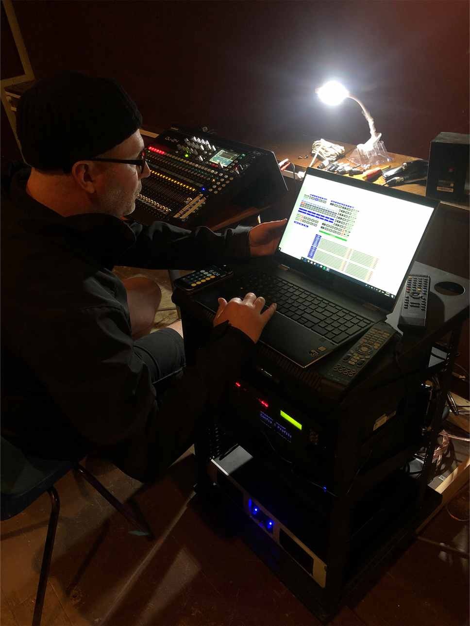 A Sound House technician formatting the new sound system at the Little Theatre in Deloraine.  Photo supplied