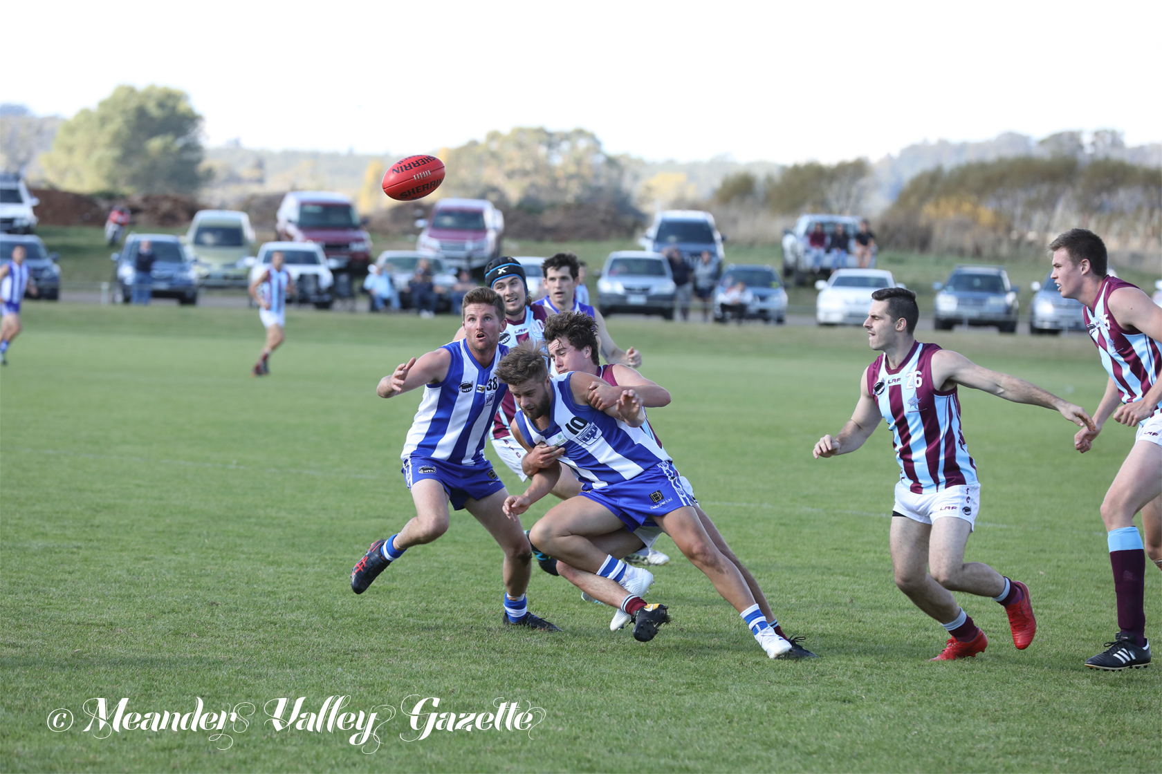 Some players keeping their eyes firmly on the ball, Deloraine Roos and Hillwood Sharks sink their teeth into the game.  Photo by Mike Moores