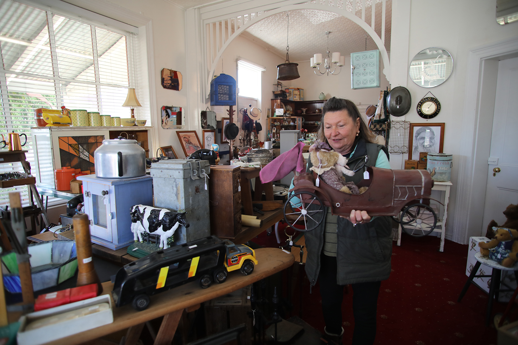 Eve Robson surrounded by a lifetime of collectables.  Photo by Mike Moores