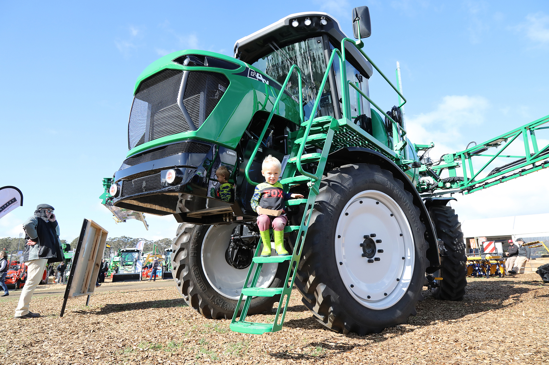 Perched on a Goldacres chemical sprayer, Tytan Wolfe, 3, of Tullah.  Photo by Mike Moores