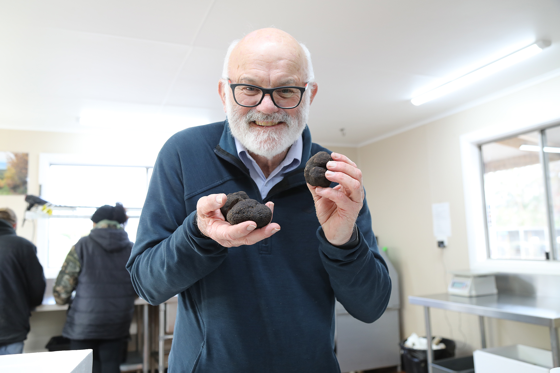 Len Mackenzie and his 'black gold' – truffles harvested at Needles in the Meander Valley.  Photo by Mike Moores