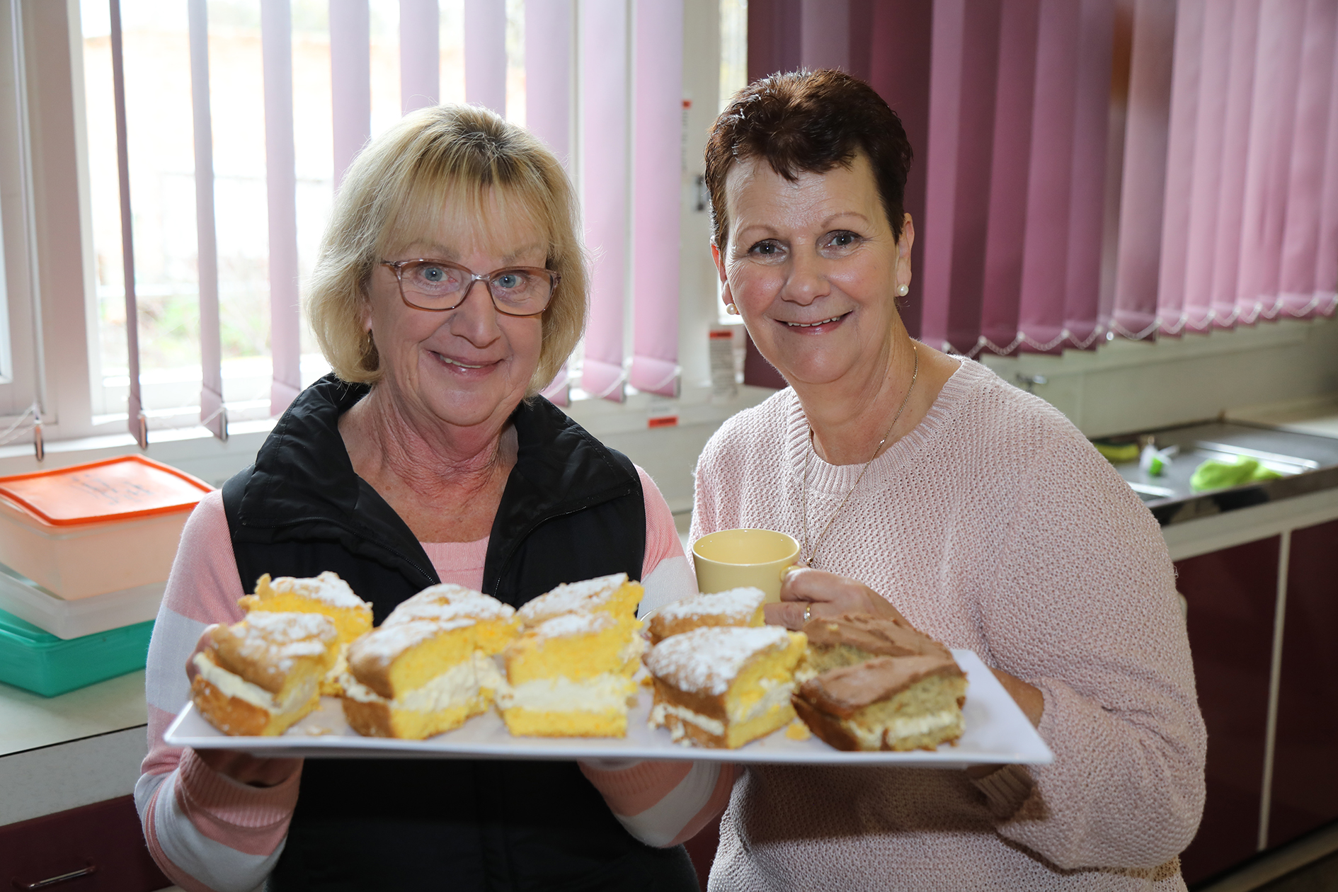 Christine Donohue (left) and Sally Donohue (right) having their cake and eating it at the Biggest Morning Tea!