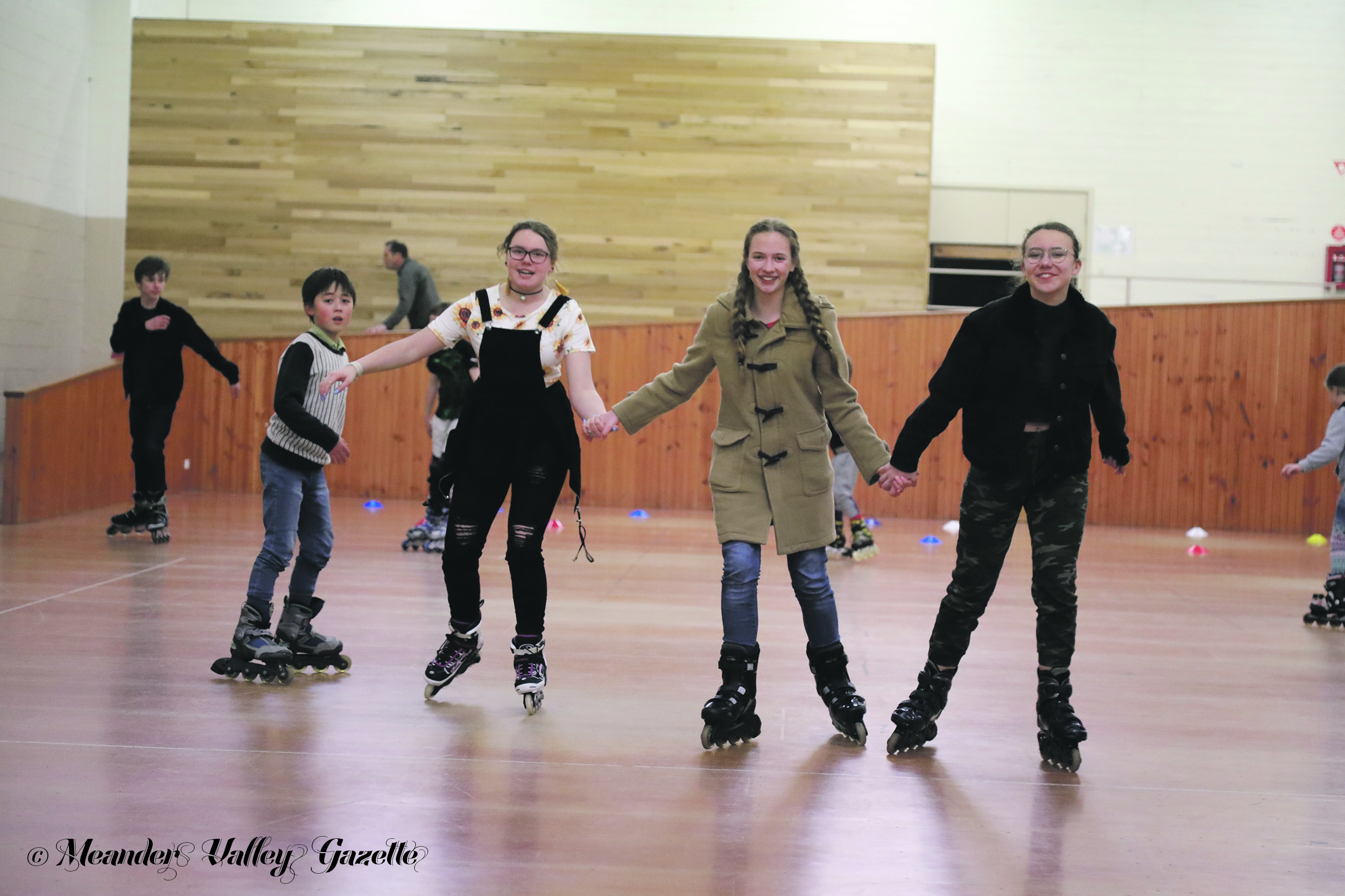 Enthusiastic in-line skaters enjoy a winter night of active fun!  Photo by Mike Moores