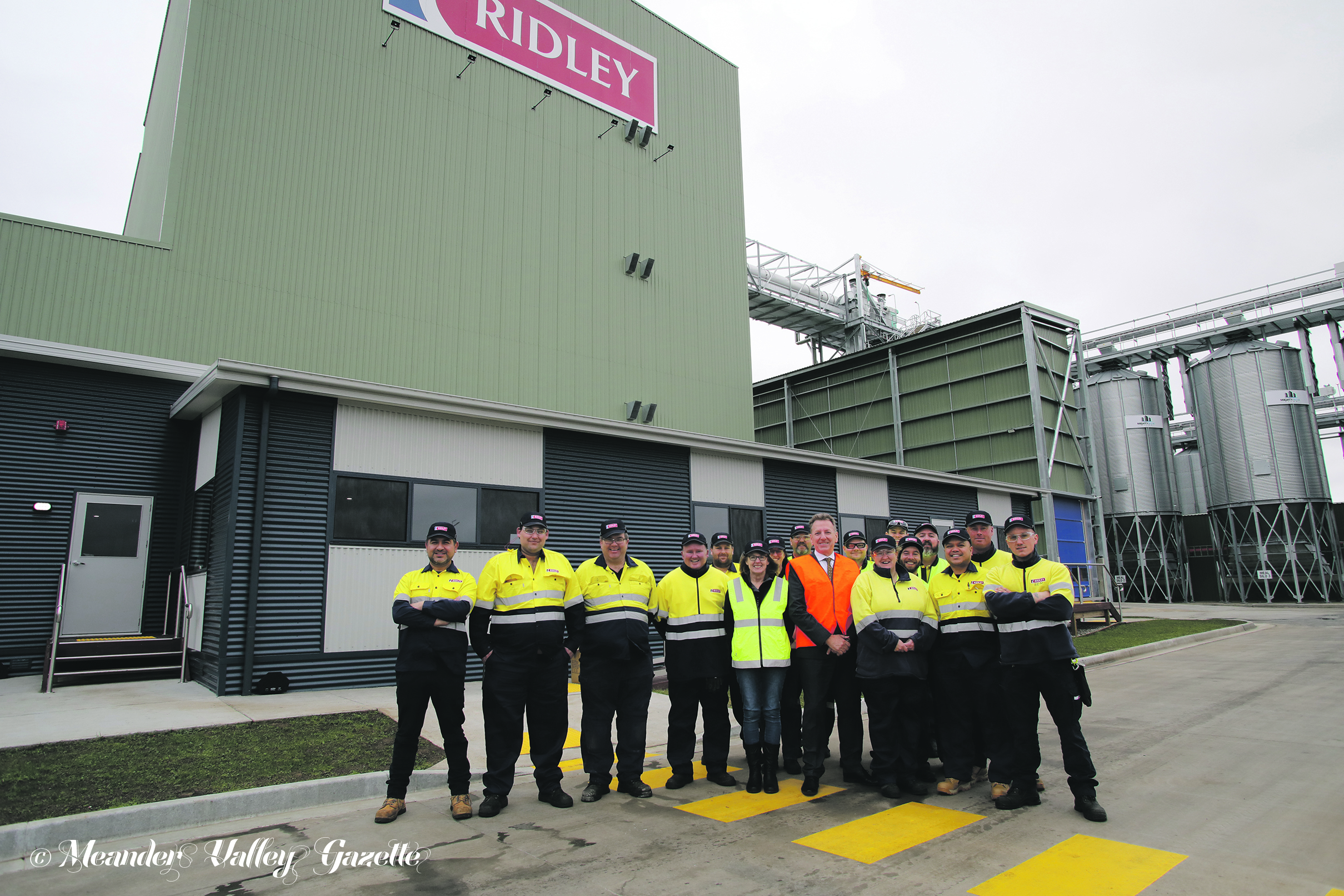 CEO David Lord, (orange vest), manager Johnny Cabercas (far left) and some of the local workers now employed by Ridley at Westbury.  Photo by Mike Moores