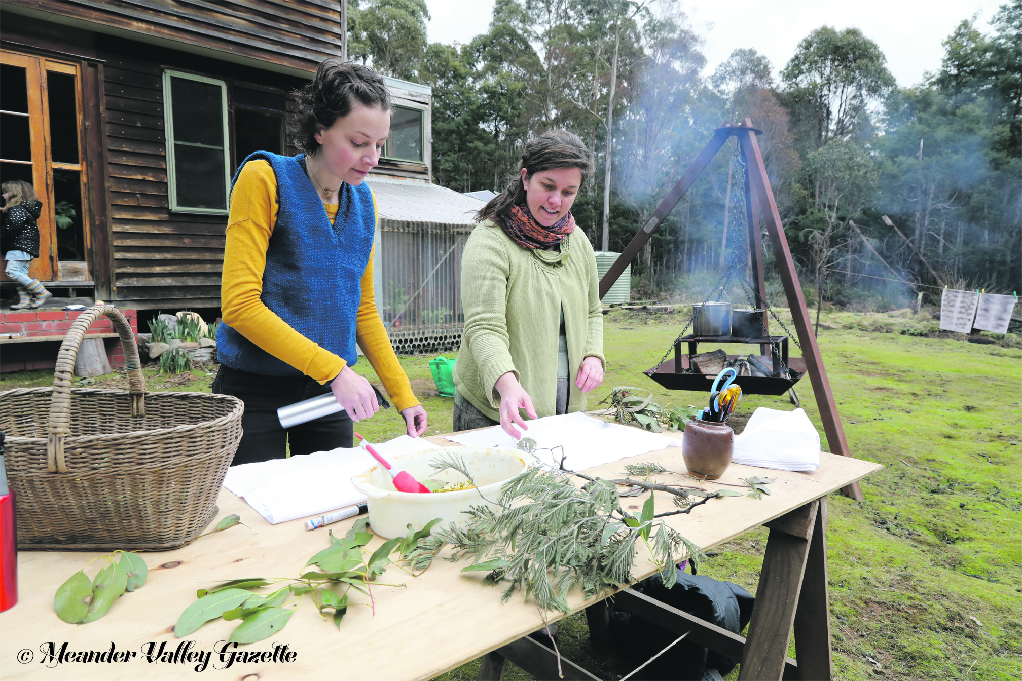 Photo by Mike Moores  Jasmine Rocca of Jackey's Marsh, an instructor at the Forest Folk workshops, preparing plants and fabric for dyeing with Bonnie McGee of Weetah.