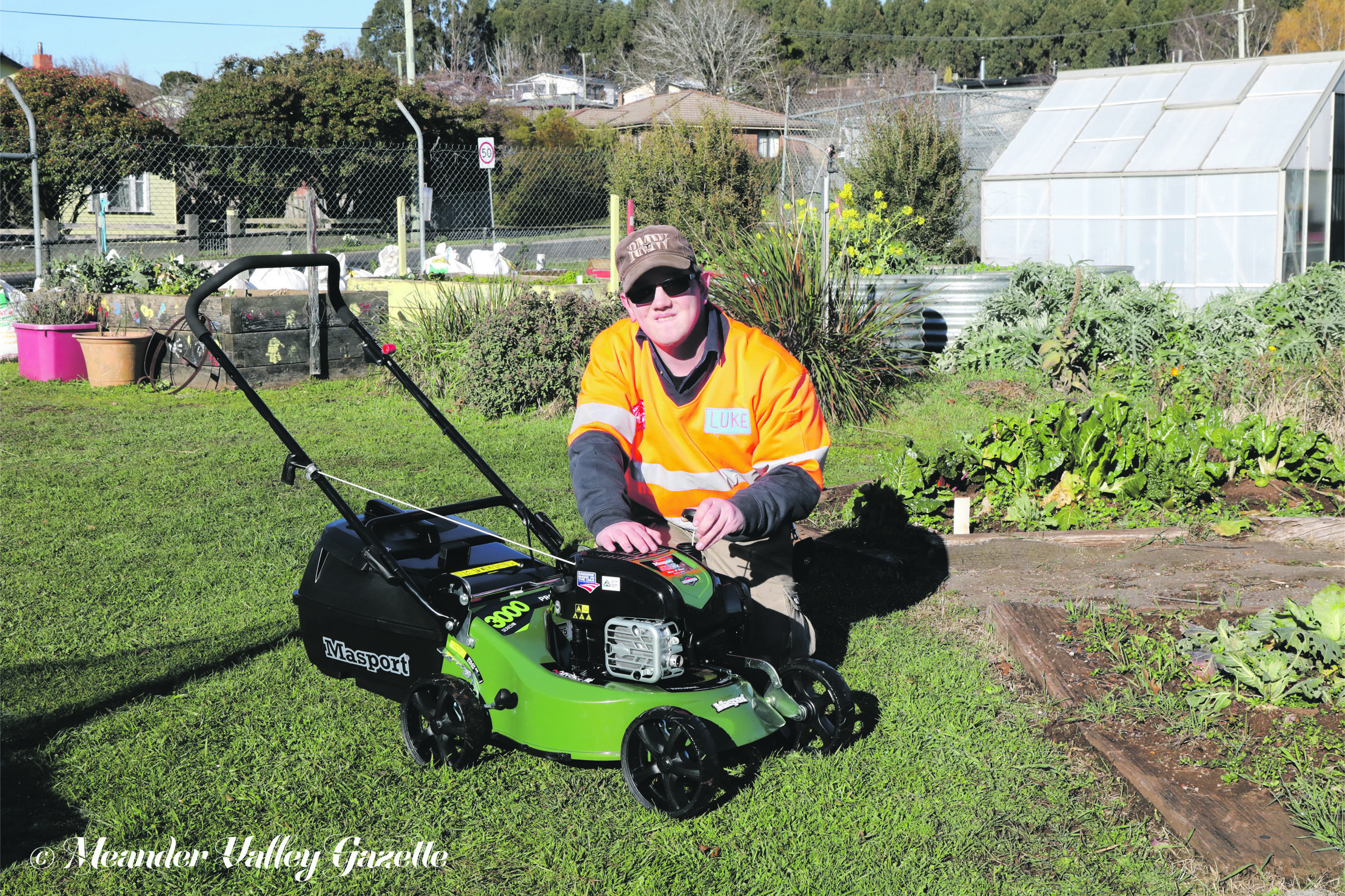 Photo by Mike Moores  Luke Cole at the Deloraine Community Garden with the new mower, courtesy of a community grant from the Meander Valley Council.