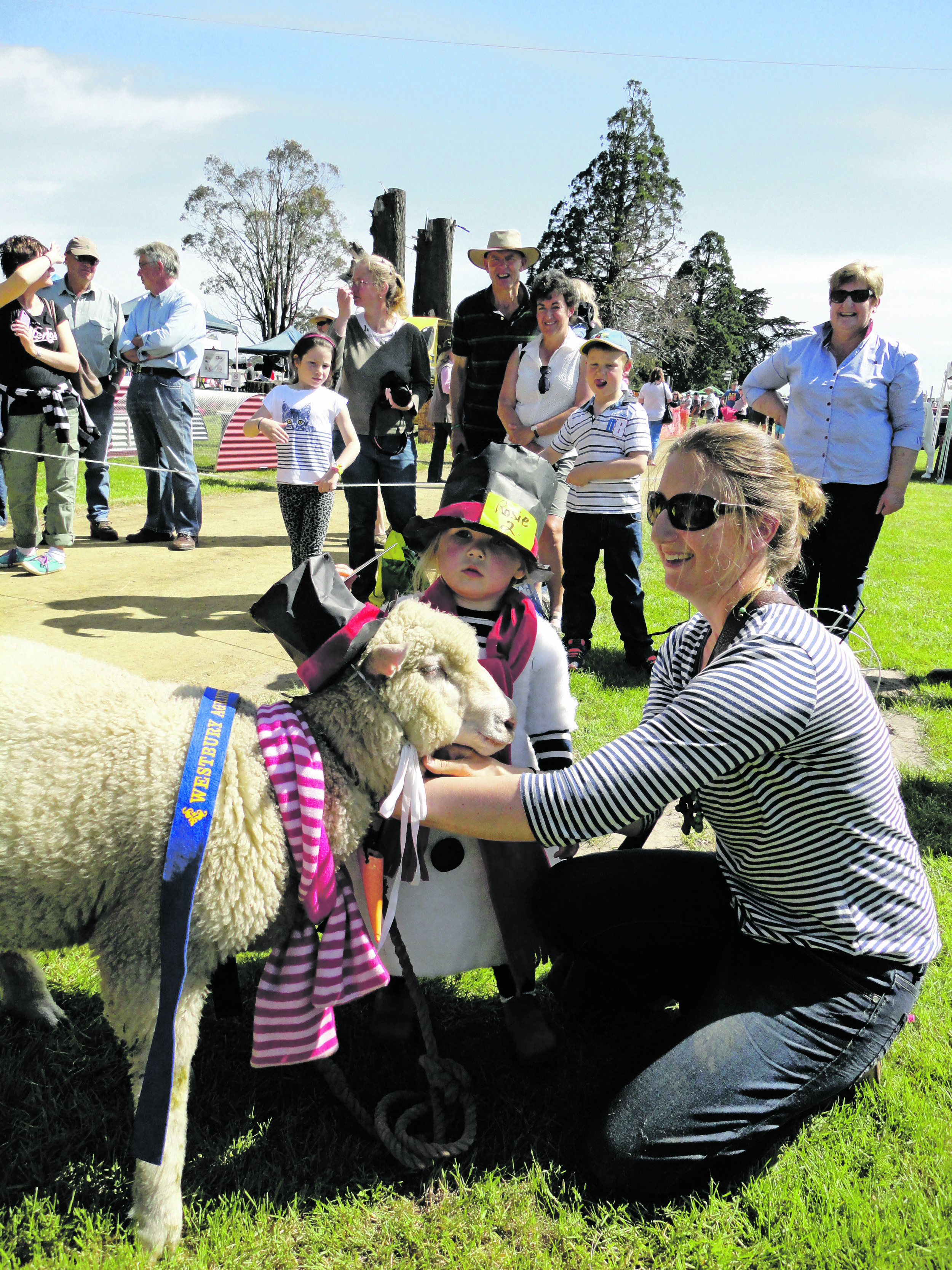 Photo supplied  Kate and Rosie Chugg with their prize winning sheep at the Westbury Show.