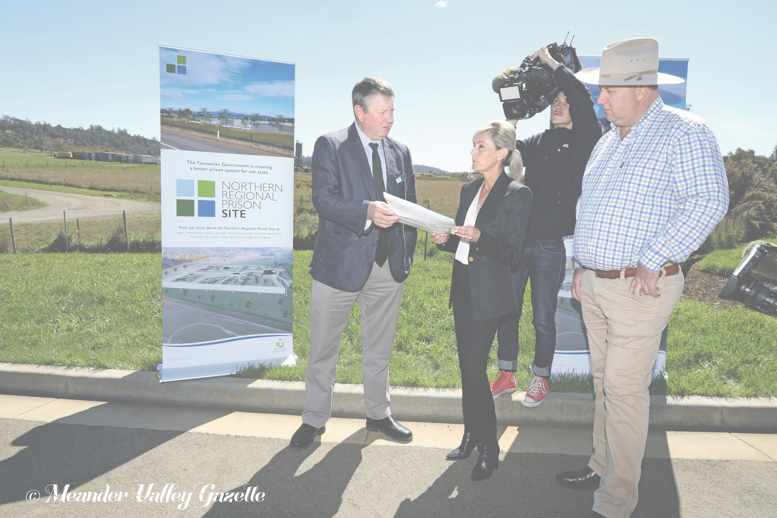 Photo by Mike Moores  Meander Valley Mayor Wayne Johnston, Corrections Minister Elise Archer and John Tucker, Liberal Member for Lyons, announce the proposed site of the new Northern Regional Prison, at the Westbury Industrial Precinct, just over the Bass Highway from the historic Westbury township.