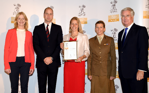 Waves Training Solutions Ltd's Strategic Growth Director Lou Whiting (centre) receives the prestigious Defence Employer Recognition Scheme gold award from HRH Prince William alongside (from left) Lucy Beaumont, quality assurance manager Emily Hewitt and Defence Secretary Michael Fallon.