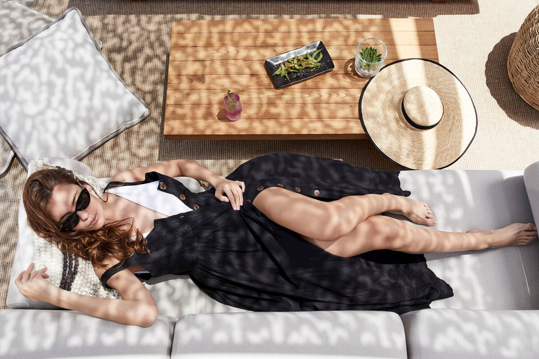 Daios-Cove-beach-women-relaxing-sunshine-the-beach-house-the-ghost-group.jpg