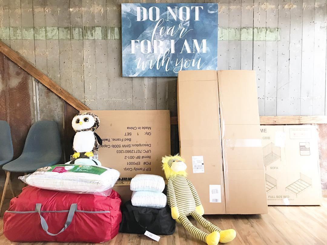 Two Welcome Packs, a crib, and a bed ready to be delivered to children entering foster care.