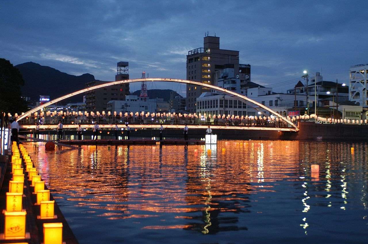 "Lanterns being placed in the Sasebo River in Japan during the Obon (or ""Bon"") Festival. Image from Wikimedia Commons."