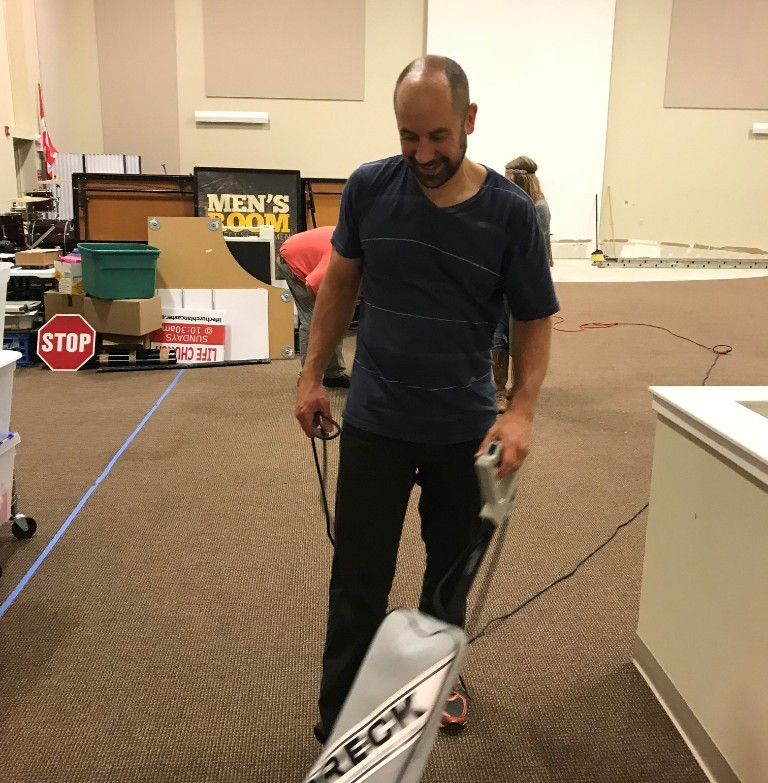 Cleaning House - We accomplish a huge task last week when our work teams emptied the building of all our remaining unwanted items. We finally have some room to breath! Thanks John for your help! That vacuum cleaner looks good on you!