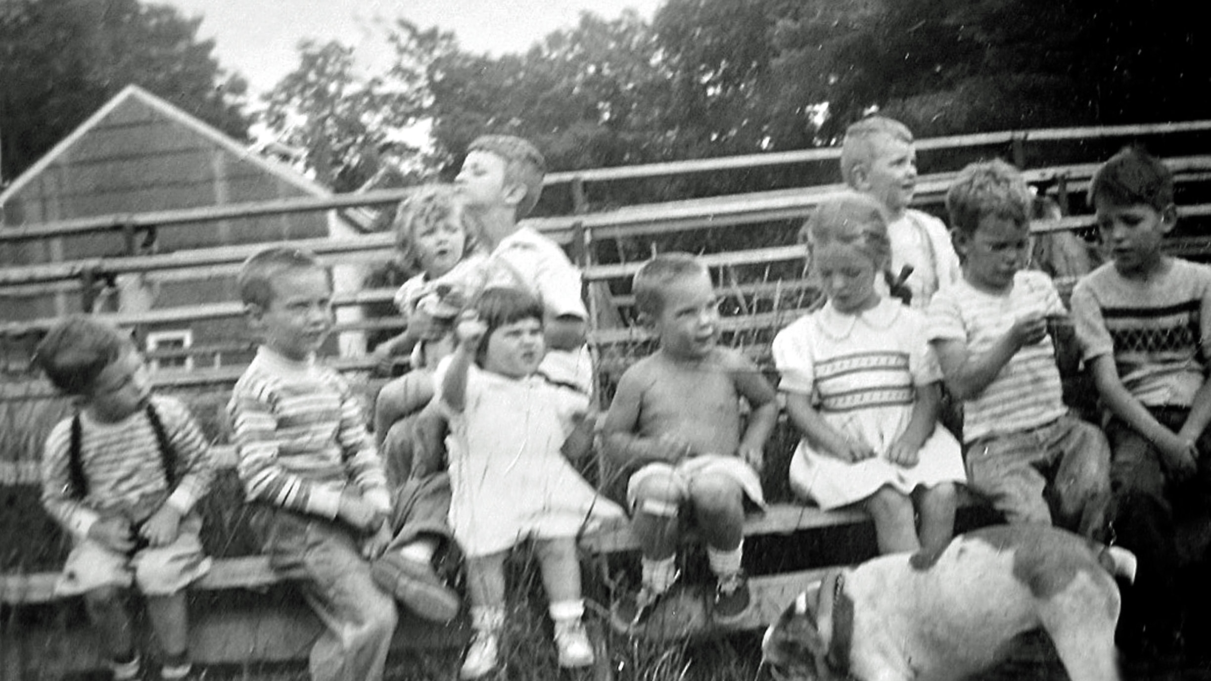 On the bleachers with friends on the New Hampton School campus circa 1951-52. Kent, suspenders and all, is on the far left. His brothers, Stuart and David, are on the far right. His bulldog, Mugsy, is front right.  CLICK ON IMAGE FOR MORE ON LIFE ON A CAMPUS