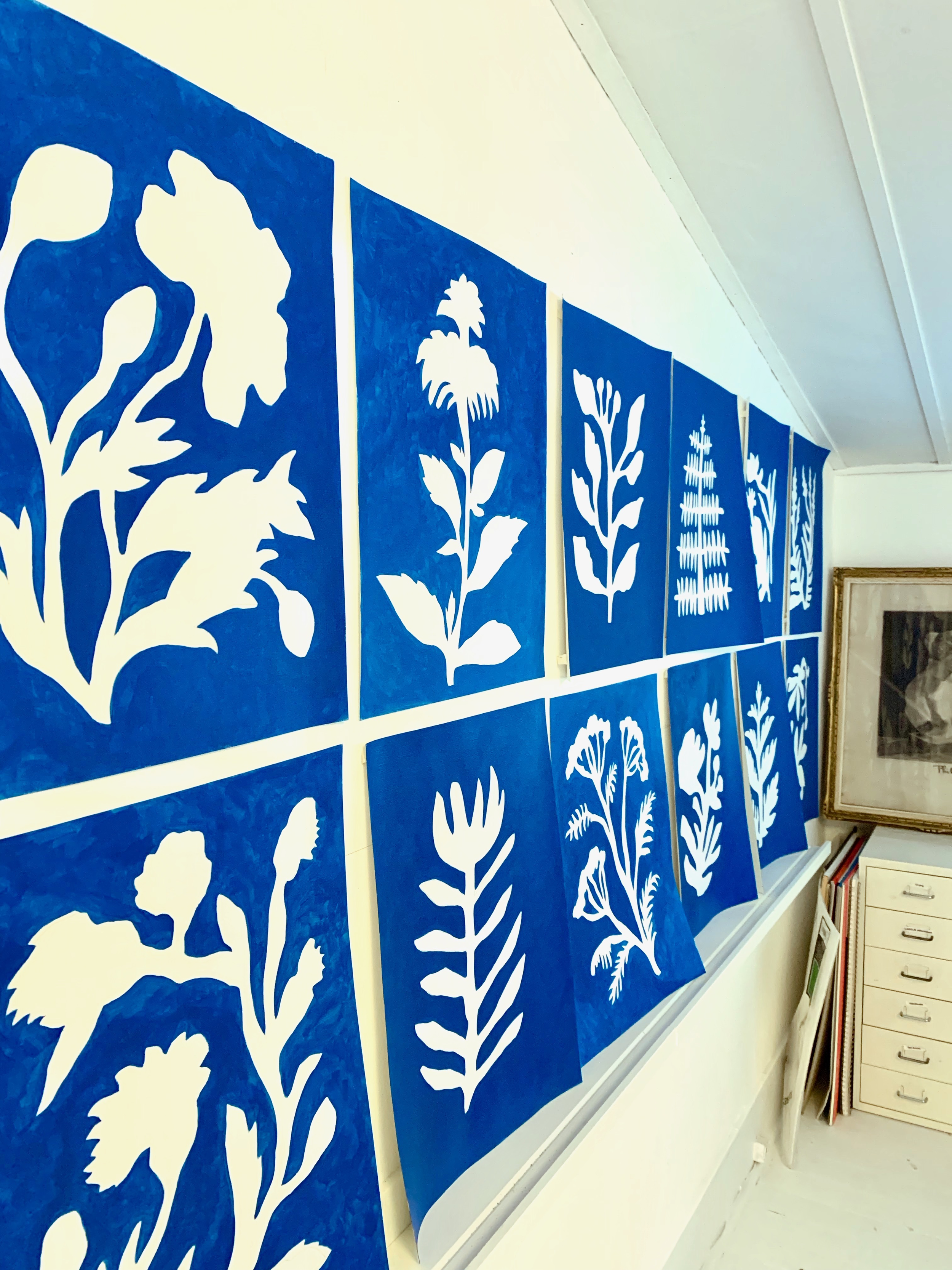 The original collection of 12 Sunprint paintings, inspired by cyanotype photography, tacked up on my studio wall.