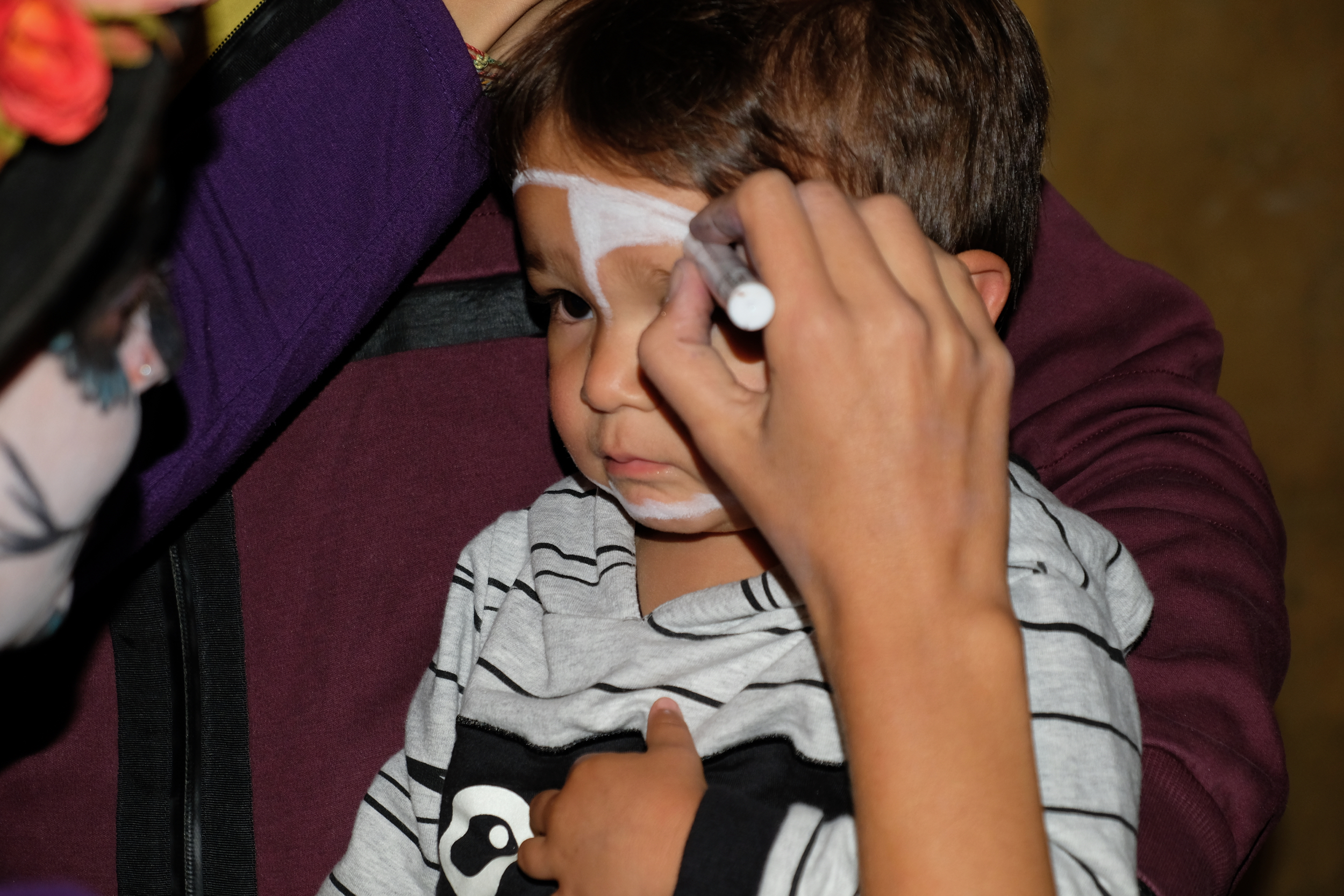 My son, Dillinger getting his face painted on the Day of the Dead