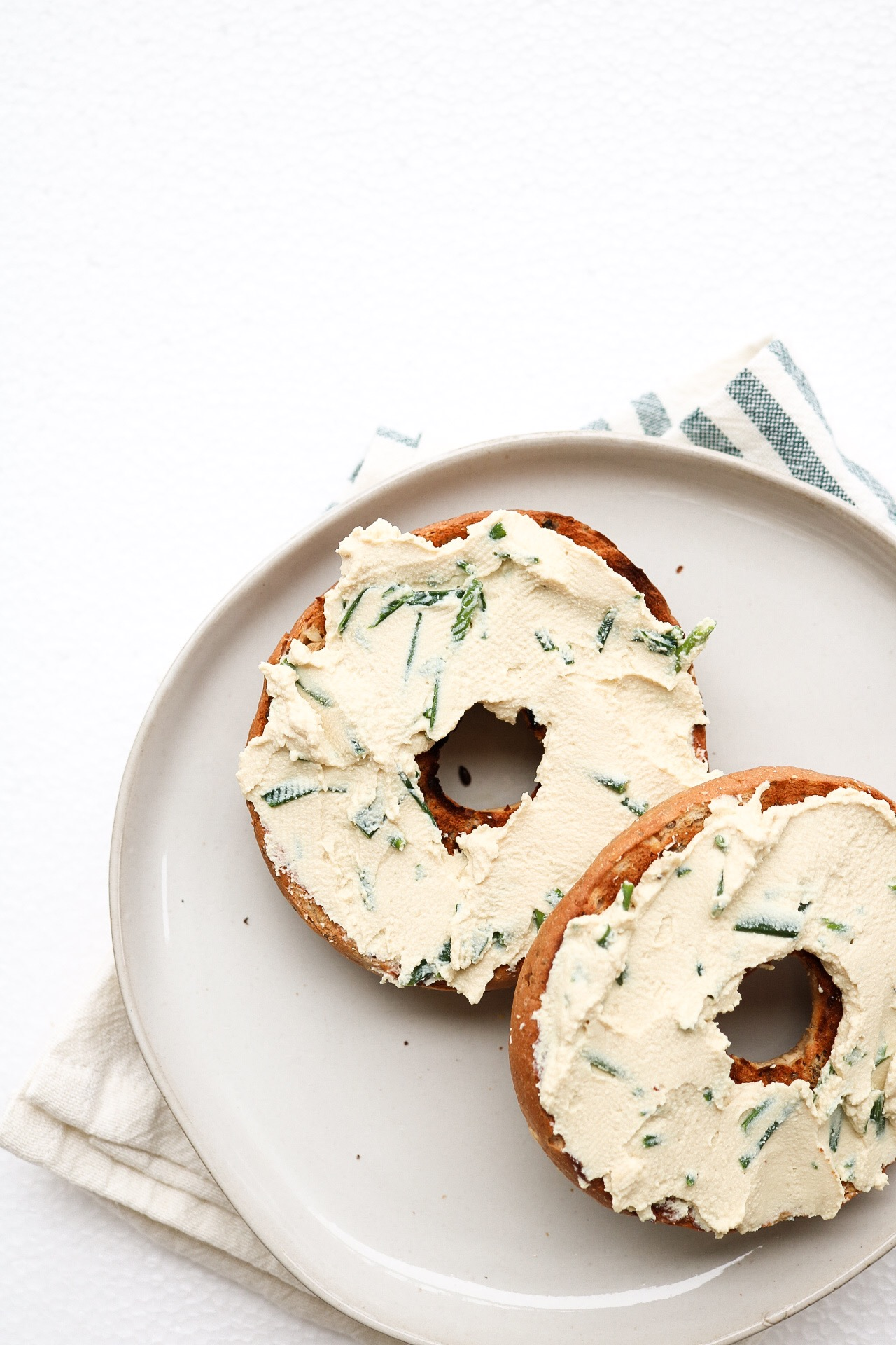 Vegan Chive Cream Cheese - INGREDIENTS:1 block extra firm tofu2 Tbsp apple cider vinegar1/4 cup nutritional yeast1 1/2 tsp salt1/2 cup plant milk1/3 cup chopped chivesDIRECTIONS:In a blender, mix together all of the ingredients, except for the chives. Once your cheese mixture is blended, pour it into a Tupperware container, and fold in your chives. Cover the mixture with a lid, and put into the fridge to firm up over-night. Allowing it to sit in the fridge lets the flavors absorb, as well as create the creamy and firm texture of a classic cream cheese.
