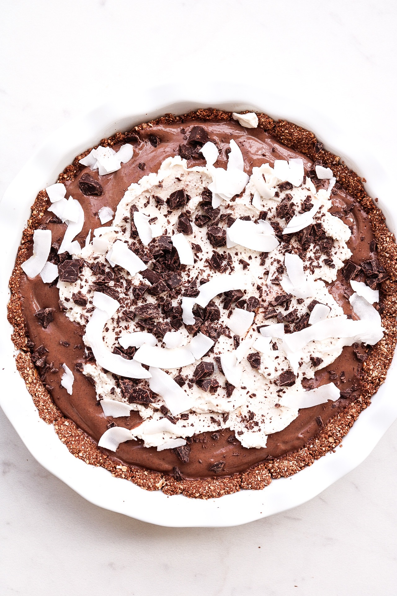 I decorated the pie with the coconut whipped cream, chopped chocolate, and coconut flakes.