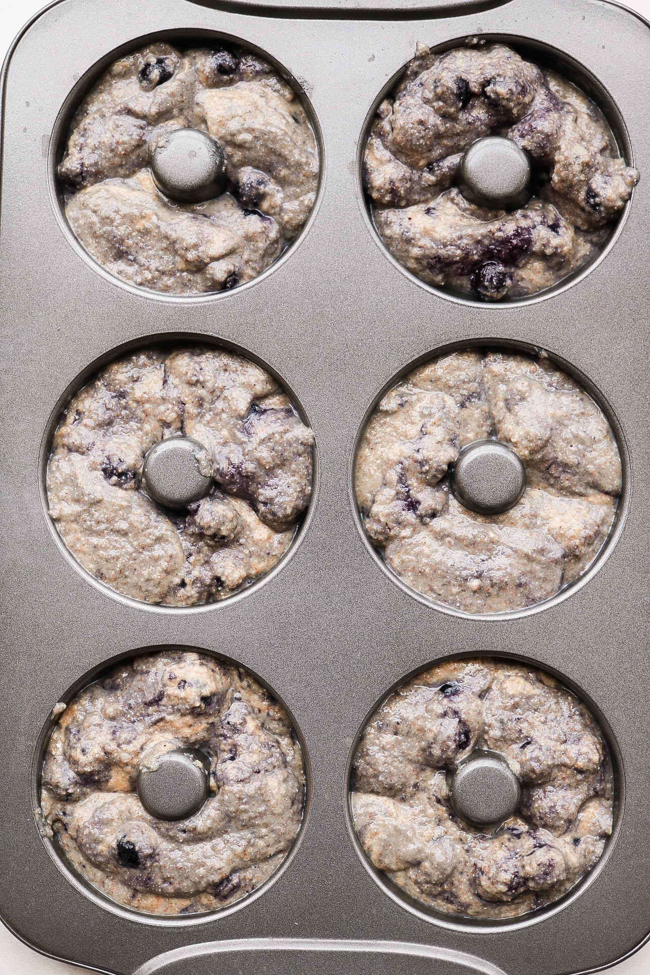 Fill up your donut pan and bake these bad boys for about 20 minutes!