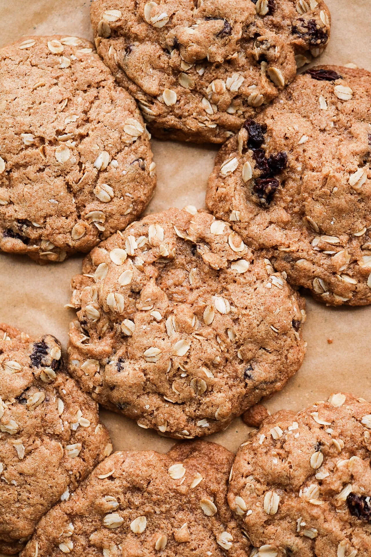 Oatmeal Walnut Raisin Cookies - INGREDIENTS:1 cup all purpose or spelt flour1/2 tsp baking powder1/4 tsp baking soda1/2 tsp salt1/2 tsp cinnamon1/3 cup melted coconut oil2/3 cup brown sugar1/4 cup warm water1/3 cup raisins1/2 cup rolled oats1/3 cup chopped walnutsINSTRUCTIONS:Preheat your oven to 350F. Line a baking sheet with parchment paper and set aside. In a medium bowl, whisk together the flour, baking soda, baking powder, salt, and cinnamon. In another bowl, mix together the sugar, oil, and water. Add the wet mixture to the dry, and fold in your raisins, walnuts, and oats. Roll out your cookie dough balls with a tablespoon, and place them on your baking sheet. Bake for 12-13 minutes!