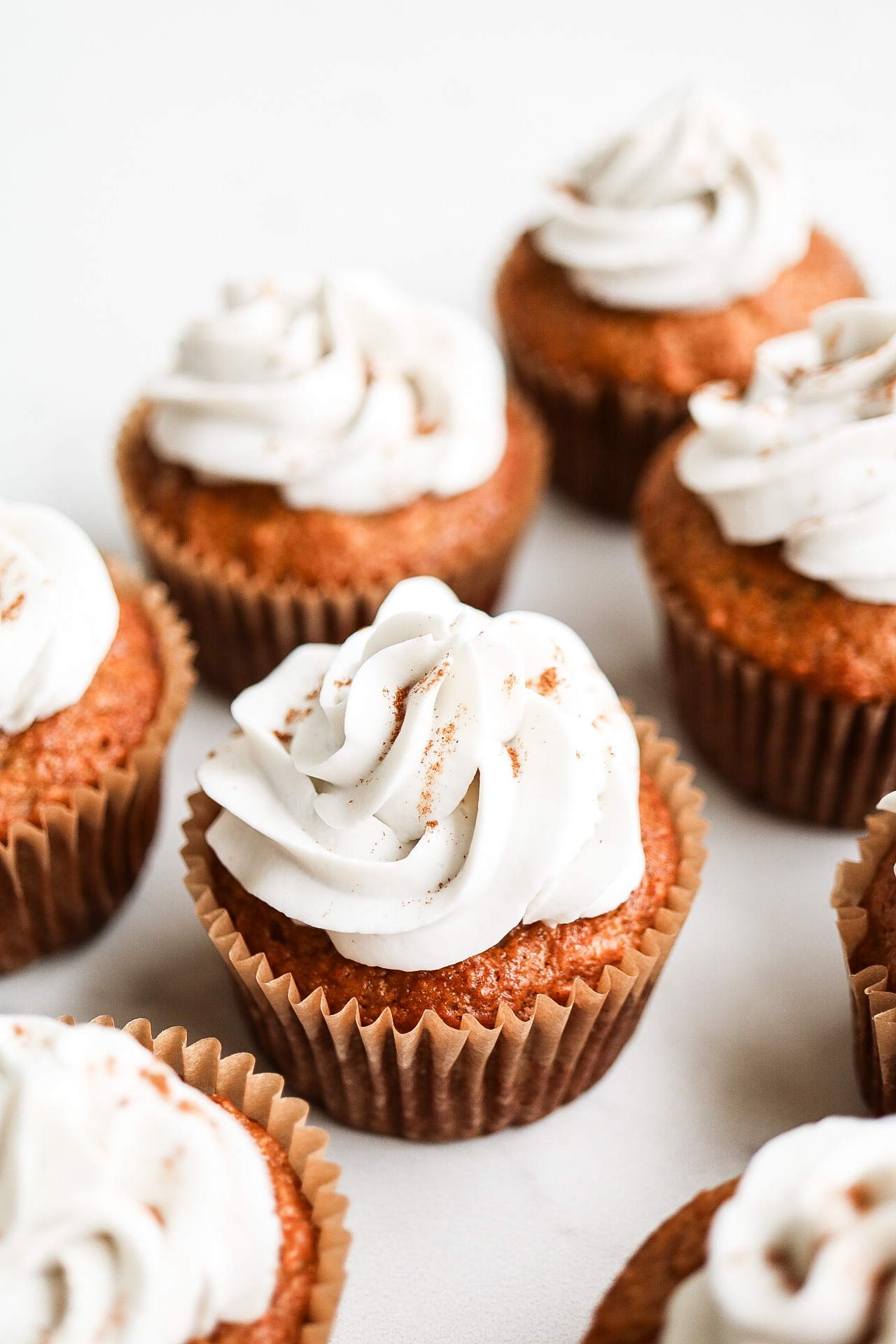 Pipe your frosting and sprinkle with a dash of cinnamon!