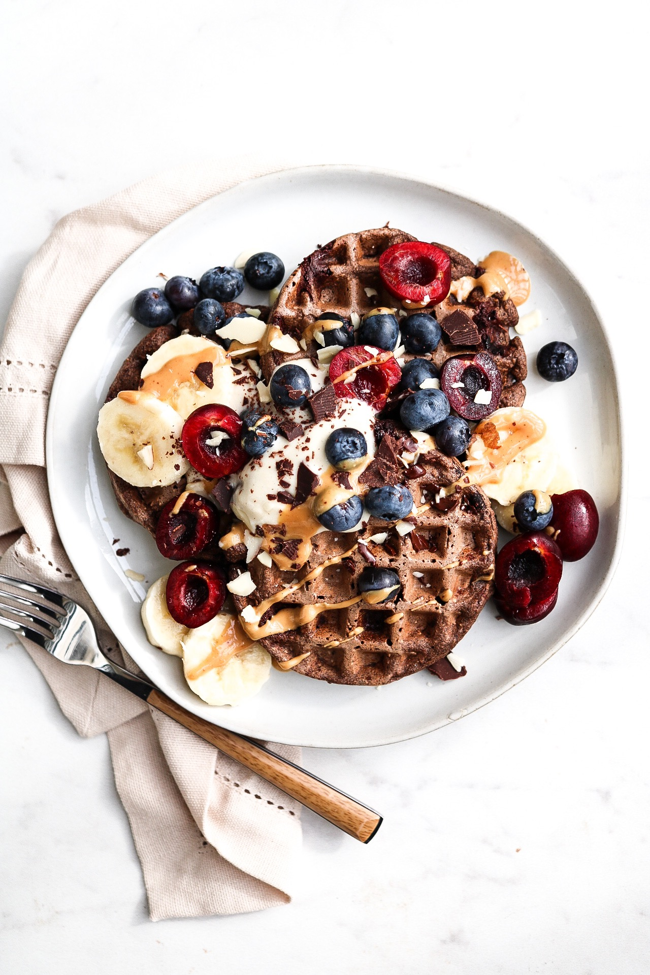 Double Chocolate Buckwheat Waffles  - INGREDIENTS:1/2 cup oats1/2 cup buckwheat flour2 Tbsp cacao powder1 tsp baking powder1 tsp apple cider vinegar1 tsp flaxseed1/2 ripe banana3/4 cup almond milk1-2 Tbsp maple syrup or sweetener of choice1/3 cup chopped Alter Eco dark chocolateINSTRUCTIONS:Blend all of the ingredients together in a food processor - then, allow the batter to sit while you preheat your waffle maker. Fold in your chopped chocolate into the batter before cooking. Put a bit of coconut oil on your waffle maker so that the waffles are easier to take out! Cook according to the waffle maker's instructions.