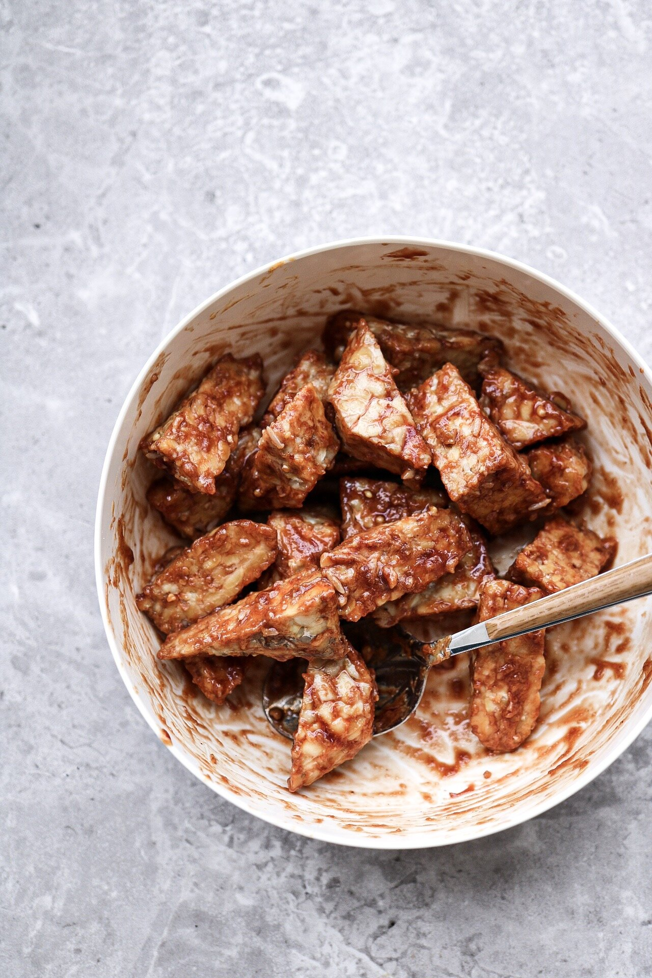 Mix your tempeh around in the sauce - then add to the baking sheet!