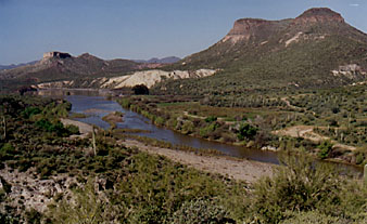 View of the Agua Fria River valley looking toward Indian Mesa (upper left), April 1998. Lake Pleasant was full after the heavy winter rains, and extended to the sandbar in the middle left of the photo. (©1998 Cliff Drowley)