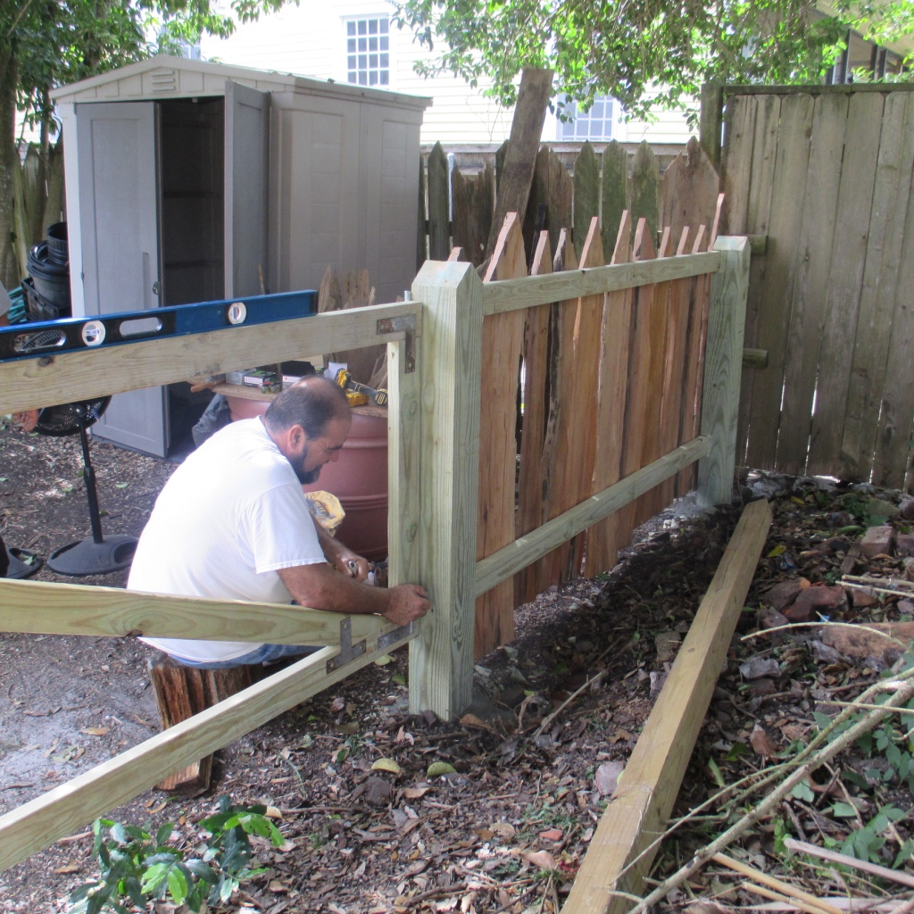 Duane Broussard building the pieux fence