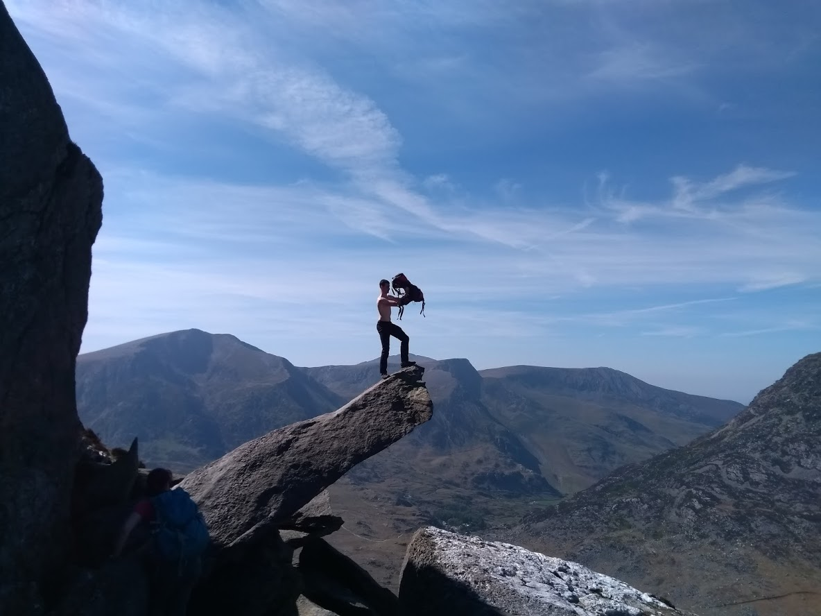 Kyle posing Lion King style with his rucksack on Tryfan's famous cannon rock