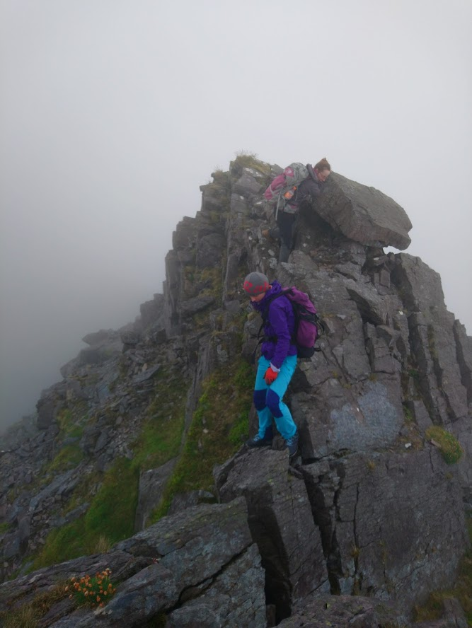 Vicky and Eva scrambling on The Bones Arete on way to Beenkeeragh (Photo: Rónán)