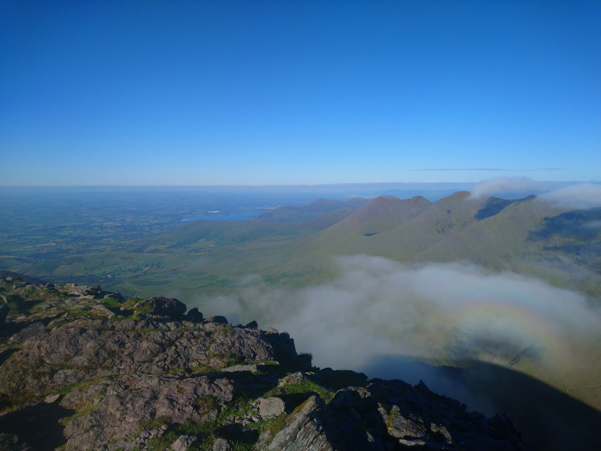 Towards Cronin's, Killarney and a rainbow from Carrauntoohill summit (photo: Rónán)