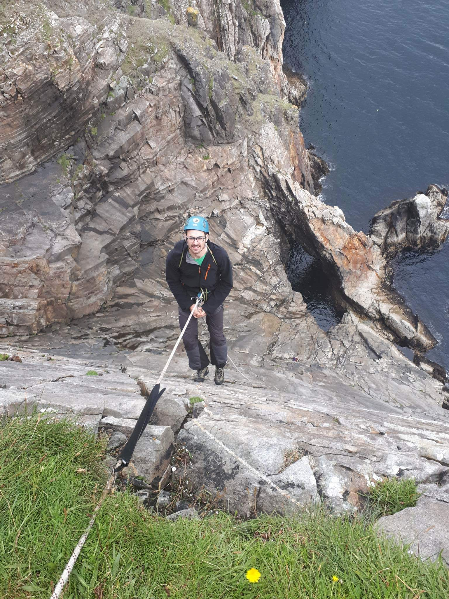 Kyle abseiling into Sail Rock