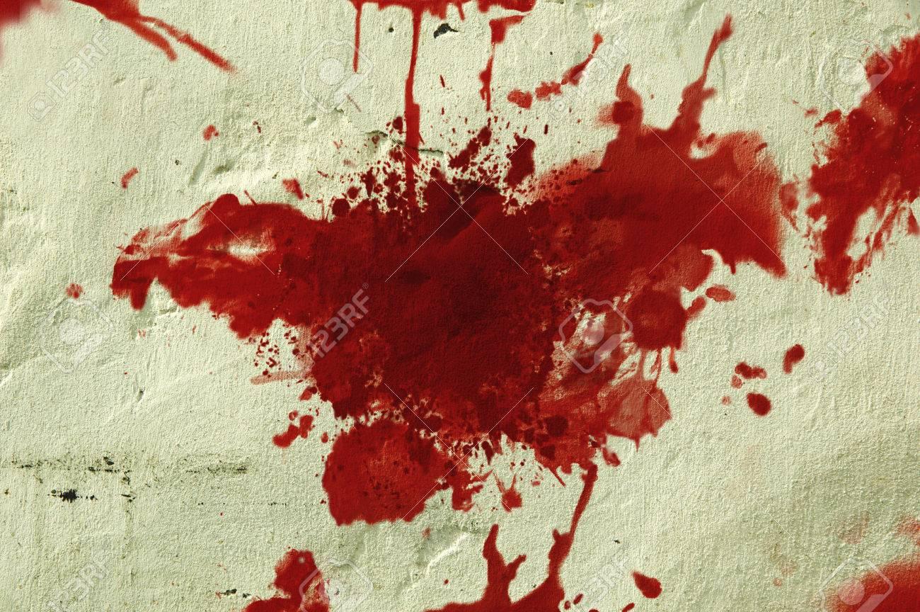 24546165-red-blood-splatter-on-a-grunge-wall.jpg