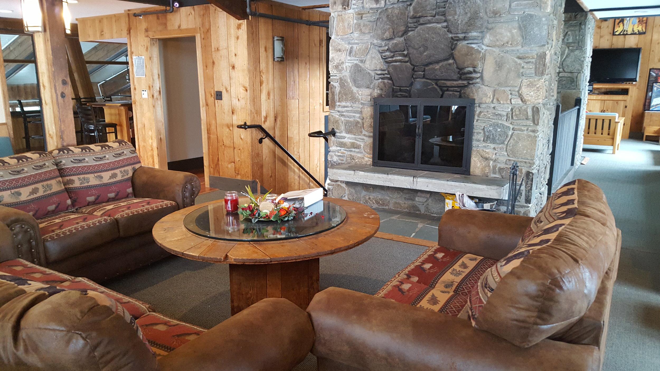Lounge by fireplace
