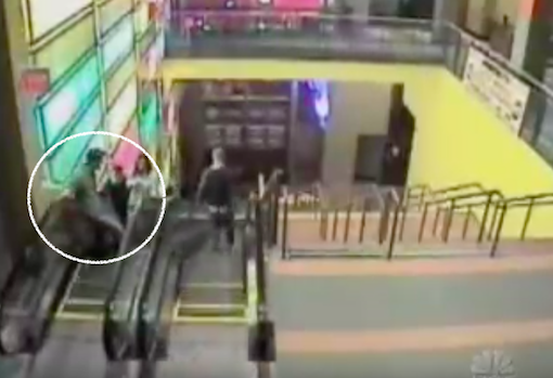1:15am - Brian, Clint and Meredith on the way up the escalator. Brian is in front, leaning on the handrail.