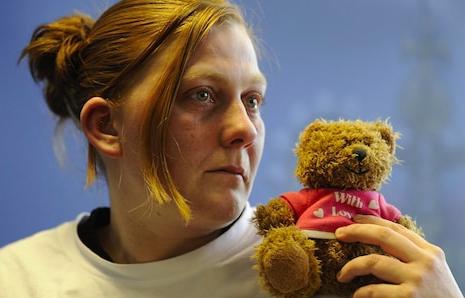 Karen Matthews holding the teddy bear (Source: The Telegraph)
