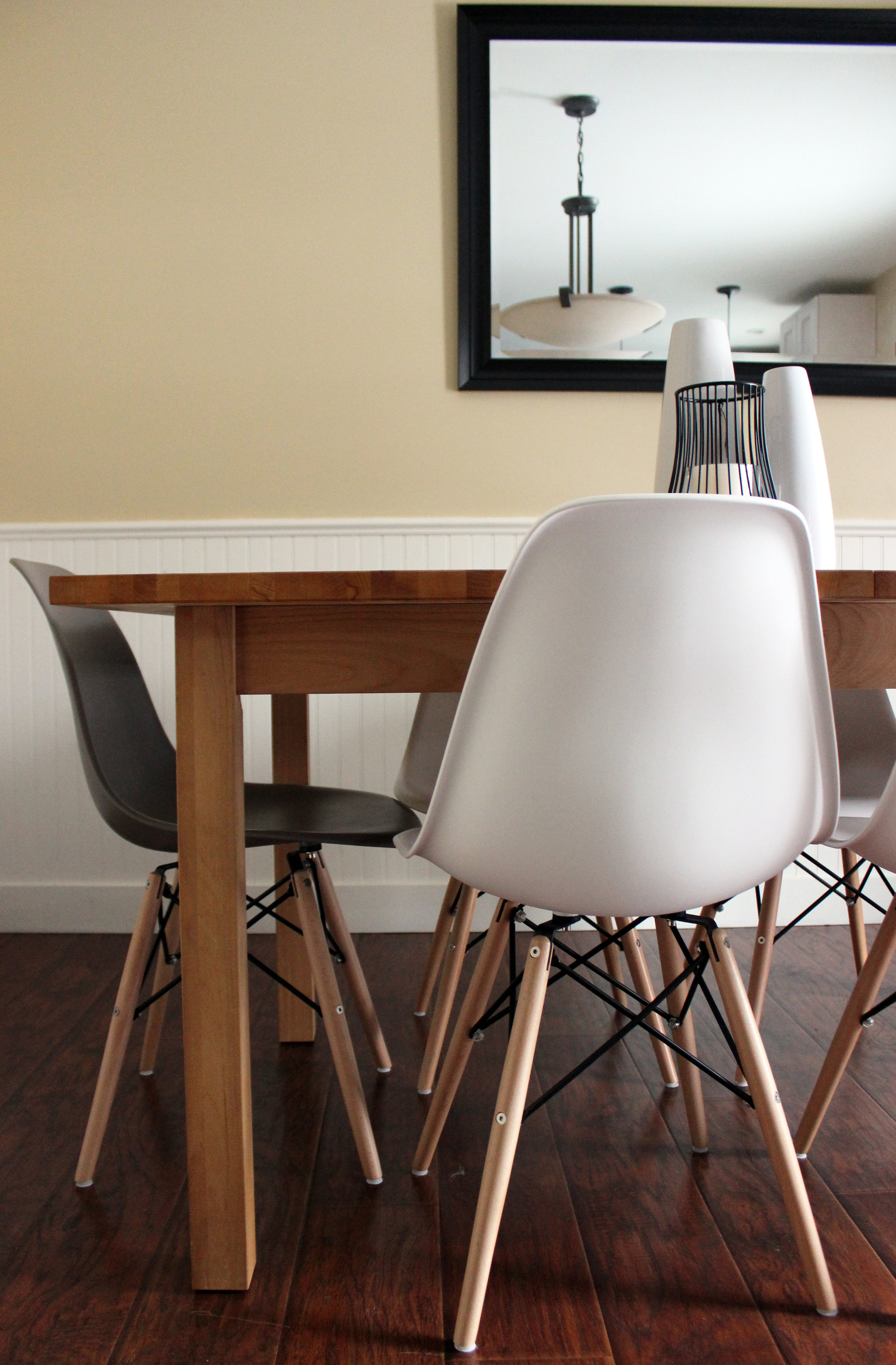 Classic Eiffel Chairs accent the wood table
